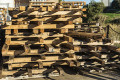 Heap of wooden pallet. Wooden pallet overlap in warehouse Stock Photos
