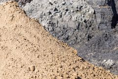Heap of yellow construction sand Stock Image