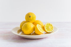 Heap of yellow lemons on a plate Royalty Free Stock Photos