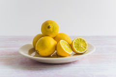Heap of yellow lemons on a plate Stock Images