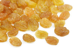 Heap of yellow raisin on white Royalty Free Stock Images