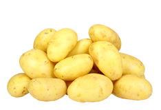Heap of yellow raw potatos. Isolated on white background. Close-up. Studio photography Stock Photography