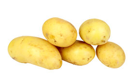 Heap of yellow raw potatos Stock Images