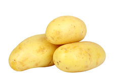 Heap of yellow raw potatos Stock Photos