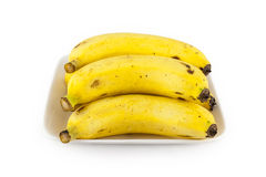 Heap of yellow ripe cavendish bananas in a white plate Royalty Free Stock Photos