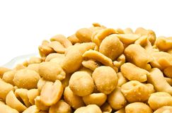 Heap of yummy roasted peanuts. On white royalty free stock image