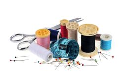 Heaped sewing equipment on white background stock photos