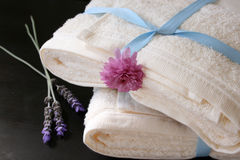 Heaped Towels. With blue ribbon and fresh flowers Royalty Free Stock Images