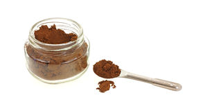 Heaping Spoon of Allspice and Jar Stock Image