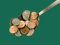 Heaping spoonful for the world economy, closeup. Stock Images