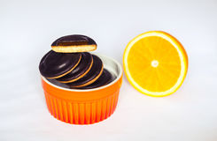 Heaps of Chocolate Chip Cookies with orange in baking dish on white background. Heaps of Chocolate Chip Cookies with orange in baking dish on white background Stock Photography