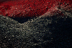 Heaps of coal in the red light Royalty Free Stock Photos