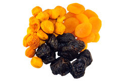 Heaps of dried fruits. Isolated three heaps of dried fruits apricots and prunes Stock Photos