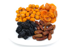 Heaps of dried fruits: prunes, dates, apricots Royalty Free Stock Photography