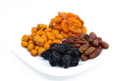 Heaps of dried fruits: prunes, dates, apricots Stock Photo