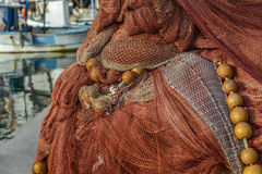 Heaps of fishing nets on the pier Royalty Free Stock Photography