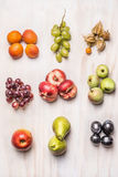 Heaps of fresh summer fruits on  white wooden background, top view Stock Image