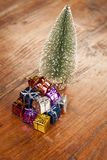 Heaps of presents under the Christmas tree. Wooden table Royalty Free Stock Photography