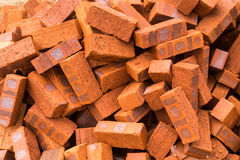Heaps of red clay bricks at construction site. Close up on heaps of red clay bricks at construction site. They are non hollow bricks with cavity filled Royalty Free Stock Photos