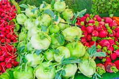 Vegetables in market stall, Antalya. The heaps of red radish and kohlrabi among other vegetables in Muratasa Friday market of Antalya, Turkey Stock Images