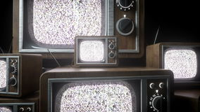 Heaps of retro, antique tv in dark room. Noise tv. Realistic 4k animation. stock footage
