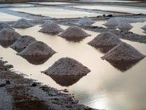 Salt heaps in evaporation ponds Royalty Free Stock Photos