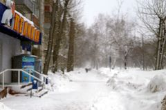 Heaps of snow in winter city streets stock image