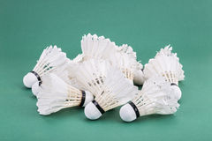 Heaps of used and worn out badminton shuttlecock on green cour Royalty Free Stock Photography