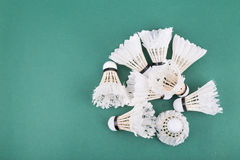 Heaps of used and worned out badminton shuttlecock on green cour Stock Photos
