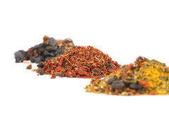 Heaps of various ground spices. On white background Royalty Free Stock Photo
