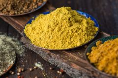 Heaps of various ground spices on wooden background. Georgian spices, Indian spices, Arabian spices. Spice variety. Herbs and spic stock image