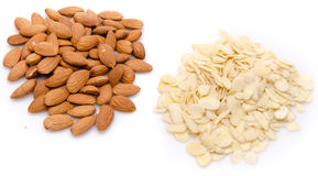 Heaps of whole and flaked almonds. On white Stock Images