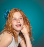 Hear that?. Young girl listens excitedly with her hand to her ear royalty free stock image