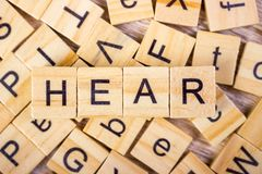 Hear - cube with letters, sign with wooden cubes Stock Photos