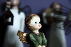 Hear my prayers. A little angel looking up in wonder as she prays royalty free stock images