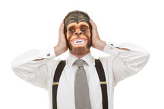Hear no evil. Businessman in monkey mask Royalty Free Stock Photo
