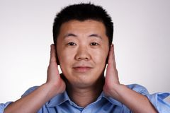 Hear No Evil. Asian guy stock images