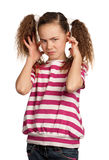 Hear no evil. Portrait of girl isolated on white background Stock Photography