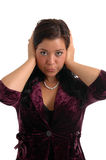 Hear No Evil. A pretty young woman covering her ears in hear no evil stock images