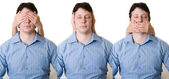 Hear No evil. Business man with hear no, see no, and speak no evil Royalty Free Stock Photography