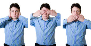 Hear No evil. Business man with hear no evil see no evil and speak no evil with black lines separating Stock Photo