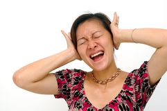 Hear No Evil. A Chinese Asian lady shut her both ears with frustration. Hear no evil Royalty Free Stock Image