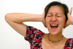 Hear No Evil. A Chinese Asian lady shut her both ears with frustration. Hear no evil Stock Photo