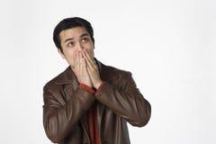 Hear no evil. Young Latino man covers his ears Royalty Free Stock Photos