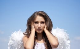 Hear no evil, angel girl and sky Royalty Free Stock Photo