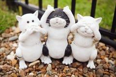 Hear no evil. Cat statue hear no evil speak no evil see no evil Stock Photos