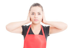 Hear no evil concept with beautiful supermarket employee Royalty Free Stock Image