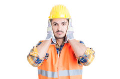 Hear no evil gesture with handsome engineer or constructor Royalty Free Stock Photo