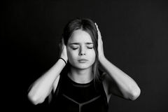 Hear no evil. The girl closes the hands. Royalty Free Stock Photos