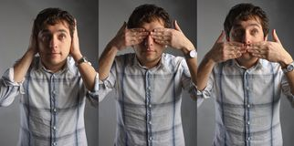 Hear no evil see no evil speak no evil. Young man doing the Three Wise Monkeys sign royalty free stock images